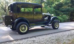 1929 Ford Model A Custom, Black and Brown Exterior, Brown & Tan cloth Interior, 354 c.i. Chrysler, Hemi Engine, 400 TH Automatic Transmission, 17,000 miles, Power Steering, Disc Brakes, 8.5 inch Linco