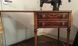 Vintage 1940's White Rotary Sewing Machine in cabinet. Cabinet in fantastic condition, and everything appears to be intact with device. Initial cord is worn away, but looks operational if wanted. Ever