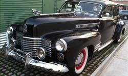 1941 Cadillac Series 62 Black four door with manual transmissionIn June and July of this year the engine was completely rebuilt professionally as well as the transmission and new clutch. Flat Head V-8