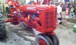 nicely restored farmall C, this tractor was completely stripped down last winter and done from the ground up, is completely re-wired with all new lights new generator and voltage regulator rebuilt sta