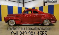 1948 Ford Coupe. This street rod has been a trophy winner for over 50 years! One look at the leaded all steel body and you can tell this is something special. This car is highly modified with changes