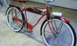 "1952 schwinn hornet 26"" balloon tire bike , new paint ,tank , decals , tires, non locking springer , skip tooth sweetheart sprocket , headlite , rear 9 hole rack , s-2 rims , recovered seat , come tak"