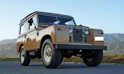 1964 Land Rover Series IIA 88 Station Wagon finished in rare Sand over Black vinyl and equipped with the extremely desirable Tropical Roof option, as well as a rear-mounted spotlight and aggressive of
