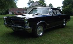 TAKE A LOOK AT THIS BLACK BEAUTY! EVERYTHING IN THIS CAR HAS BEEN REPLACED OR REBUILT. THIS PRO-STREET IS READY FOR THE HIGHWAY OR THE STRIP!!!  1965 PONTIAC GTO: TUBBED AND CHECK OUT THOSE TIRES!  PO
