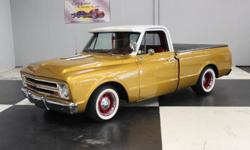 Stk#024 1967 Chevy C10 Pickup-Shortbed Painted Inca Gold BC/CC with a white top. The front and rear bumpers, door handles are all like new. There is a working spot light on the drivers side, dual outs