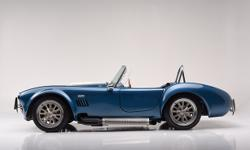 This beautiful 427 SC Cobra replica was built by Bennett Automotive, and is finished in Guardsman Blue with Wimbledon White stripes This piece is a bona fide high-performance driving machine that inco