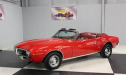 Stk#067 1967 Pontiac Firebird This beautiful Regimental Red BC/CC has an Ivory Convertible top, chrome Rally rims with flat caps and almost new Goodyear Radial GT tires, wheel well moldings that are l