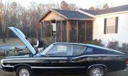 1968 Ford Torino GT Fastback This American classic currently has 86,000 miles and in great condition Black Metallic exterior and with a Blue with a Black Trim vinyl interior Equipped with a 390 cubic