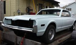 It is a very clean all numbers matching car, including sheet metal. A nice easy project for someone with the time and ability to complete it...I don't. It is a Cougar Hardtop base (not XR7) with the G