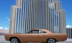 This 1969 Plymouth Road Runner 2dr Coupe includes a 440 V-8 6-Pack 8cyl Gasoline engine. It is equipped with a 4 Speed Manual transmission. The vehicle is Gold with a Brown Cloth interior. It is provi