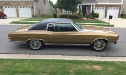 Rare first year 1970 Chevy Monte Carlo. It has gold paint with a black top. I am the 3rd owner of the car. It was purchased by a lady that had it for many years before passing away. It was then purcha