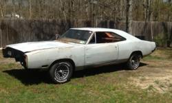 1970 DODGE CHARGER 440 AUTO WAS A 318 4SPEED CAR WHEN IT STARTED ITS LIFE CAR WILL NEED FULL RESTORATION QUARTERS ARE NEWER FENDERS ARE OK FLOORS AND TRUNK NEEDS REPLACING.HAS ALOT OF MISC. PARTS NO I