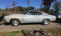 1972 Chevelle Malibu. Running driving project. 350 with automatic transmission. Engine smokes, no water in engine. Dual exhaust. Needs body work.