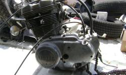 Selling some leftover parts from a 1974 Yamaha TX500 motorcycle. Complete engine less carbs (doesn't turn over), gas tank, forks, bars, ign. coils, rear fender, front fender, wheel, and some other mis
