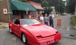 1987 Pontiac Tojan Trans Am for sale (AR) - $14,900. 60k original miles. Automatic. 305 engine. Customized outside paint- Metal Flake Red. Black Leather interior, Recaro custom-made racing seats. Powe