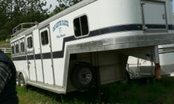 Drop Down feed doors, lots of storage, rear tack, Electric hook ups, Air conditioning, queen size bed area, also plenty of extra storage in house of trailer, Hay rack. Please call only if interested p