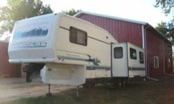 1994 Damon Escaper 5th Wheel. This 30 foot RV is in great condition and has a very nice floor plan. It has one big slider to move the dining table and 4 chairs and living room areas out. It has always