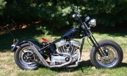 This is 1995 Sportster that had a 1200cc Wisco Piston upgrade and a bolt in Cam upgrade, Kraft Tech Rigid Frame (Powder Coated), DNA Springer Front End, Fat Rims, Fat Tires, Oil & Gas Tank, Red Tail S