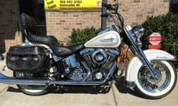 VERY VERY SPECIAL BIKE......NEW HARLEY DAVIDSON FACTORY PAINT (SENT TO MILWAUKEE WI.)...SCREAMIN EAGLE HEADS.....LOW LOW MILES......FISH TAIL PERFORMANCE EXHAUST......PASSENGER BACKREST......LOTS AND