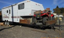 This is a very clean 1996 Jayco Eagle toyhauler, with a 13' slide, it sleeps 6 people, (4) new 10 Ply tires, new awning, new floor, A/C, microwave, gas/electric fridge, queen bed, booth dinette, and a
