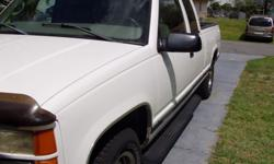 1998 G M C 1500 SIERRA EXTENDED CAB. This truck has 124824 miles on it. The interior is Gray cloth seats. There is a place on the drivers seat that has a Tear.(PLEASE SEE PICTURE). There is also a Cra