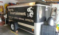 Trailer has been in a garage for most of the time. Twelve custom tie downs inside and front mounted new spare tire.2500 lb gross weight, Empty weight 1100 lb. Rounded nose, full rear door, low clearan