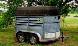 2 Horse Stock Trailer for sale. Works Great! It has compartments at the front of the trailer. It will need new tires. That is why it is only $1,300. I need to sell soon. First come, first served. Call
