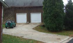 Large Garage / Barn over 1000 sq. ft. of floor space  For rent is this very large garage / barn.  This property is section in two; we are renting the section on the right.  Features include separately metered electricity, lighting, and a 10 ft high