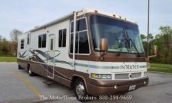 Model 351 with slide-out. A very nice 2nd owner Class A coach awaiting your travels. Built on a Ford Chassis and powered by a 6.8 L Triton V-10, auto O/D transmission, 33,149 low miles, hydraulic leve