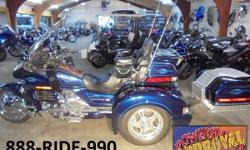 2000 Honda Goldwing Trike. This Goldwing is absoluetly perfect with a champion trike conversion, new rubber on the front and a new chrome wheel, tall windshield chrome mags, custom pinstriping, and mu