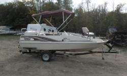 Up for Auction: Stock # 6132 - 2000 Lowe Suncruiser Tahiti 192 Deck Boat with Johnson 150 on Lowe Bunk Trailer. This boat and motor was submerged. The Johnson 150HP two stroke motor was submerged. It