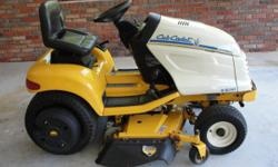 """2001 Cub Cadet Riding Lawn Mower - 3000 Series. 163 hrs. The mower was purchased from actual Cub Cadet Dealer. Hydrastatic Drive, 48"""" Cut. Shaft Driven. Power Lift & Power Steering. Has Cup Holder. De"""
