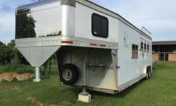 This is a 2001 EBY Legacy series three horse slant load three horse trailer. Rear tack, 10 foot short wall this is all aluminum. Living quarters partially completed. Price includes all living quarters