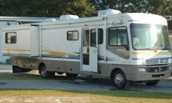 This motorhome is a 36' Class A Recreational Vehicle with 28105 miles. It rests 6. With a Chevy 8.1 L Engine, generator and 2 roof AIR CONDITIONING's; this motorhome likewise has leveling jacks, tilt