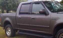 AWESOME AND SOLID 2003 f150 Ford Truck !!! Charcoal Gray in and out.. almost new looking and rides like new! Only 103,000 & some odd miles on it..... ( 4 X 4 ) Almost NEW looking interior down too the