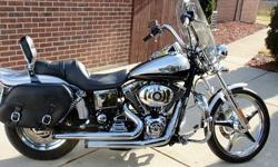 Lots of extras including crash bar, Rhinehart Racing pipes,leather bags, extra running lights, removable windshield,custom wheels, added chrome covers and touring pegs.When you contact me please inclu