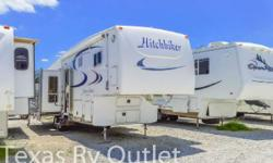 2003 HitchHiker 35RL Lets upgrade to that luxury fifth wheel Saturday is coming and its time the family gets some fresh air and enjoy the great outdoors. Four slides will open up your mind to a qualit