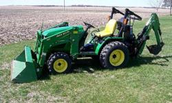 """I purchased New on April 18 2003.   Also included is a John Deere 60"""" Heavy Duty mower deck (belly mount mower) purchased New April 18 2003.   John Deere 46 Quick Detach Backhoe.   Reach from center l"""
