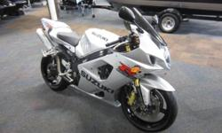 2003 SUZUKI GSX-R1000! Features include: 988 cc liquid-cooled 4-stroke 16-valve DOHC fuel injected engine, 6-speed transmission, gauges including; digital speedometer, odometer, clock, engine temp, an