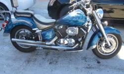 2004 Yamaha 1100 XVS V Star Custom paint w/Ghost flames Snake skin his/hers seats w/Sissy bar BUB pipes Front Twin Slotted/Drilled Disc Brakes Rear Slotted/Drilled Disc Brakes Well taken care of..Runs