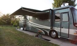 This is a Class A 2005 Holiday Rambler Scepter with a PDQ floor plan. It is 40 FT in length with 4 slides. This RV is powered by a Cummins ISL 400HP diesel engine with 91,797 miles and an automatic tr