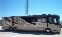 2005 Monaco Executive 45 CAQ 4 slides with Optional 515HP Detroit, series 60 powerplant and 10KW Onan diesel gen, AQUAHOT hydronic, heating and optional baseboard heater, 3 ducted roof A/cs Girrard, power awnings with wind sensor, 50 amp power cord reel,