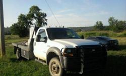 2006 F350 white flatbed truck.  It has 117,000 miles.  In excellent condition mostly highway miles well taken care of.  4x4 works great!  Long flat bed looks good with si