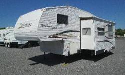 2006 Freedom Spirit by Dutchmen model FS240B-M5 This camper is 27' long and 8 ' wide with a super slide. Designed to sleep up to 8. There is a private bedroom with a queen size bed, a couch that makes