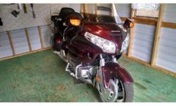 2006 Honda GL1800 Gold Wing. Audio control- Navi XM- New tires- Arm rest- Back rest- Extra lights- Highway boards- Garage kept- Extra nice- 1800cc- Dark red- 44841 miles- Rear Compartments- Saddle Bag