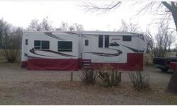 2006 Keystone Everest in excellent condition. This camper is 38' long, has four slides; two living room, one kitchen and one bedroom, new washer/dryer unit, hydraulic jacks, 50 amp service and comes w
