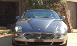 V8 PADDLE SHIFT LOW MILESTouring Gray over black leather 13k miles. This modified variant of Maseratis Coupe and Spyder models comes equipped with more aggressive body work carbon fiber interior trim