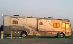 "This beautiful full body painted w/titanium pear 2006 Tiffin Motorhome,Phaeton model 40QSH, approximately 40'5"", Interior height 12'7"", overall width 101"", interior width 96"" with Caterpillar Engine 3"