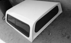 Toyata Tacoma 2006 camper shell great conditions semi new for a Toyata 2006 regular cab color white the windows are in great condition as well as the door holders the shell is in great conditions the