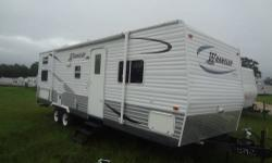 Don?t rent?.Own Your Own!! Take with you when you move!! Will make excellent temp home for working in the oil field!!! What a Deal! Own a 30ft 2006 Wrangler Travel Trailer w/Slide Out for as little as $25,000/OBO! This unit is in great condition inside &